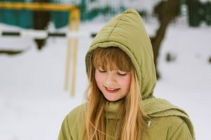young blonde girl winter portrait