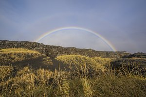 Rainbow Over Cliffs in Iceland