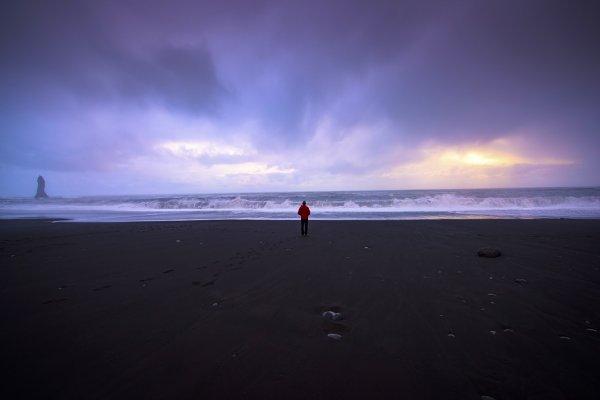 Man Standing Alone Black Sand Beach