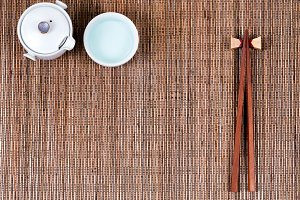Bamboo mat with utensils and tea
