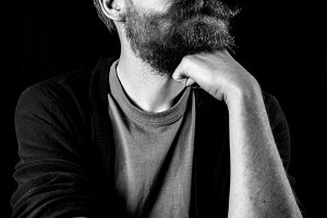 Bearded Man Against Black Background