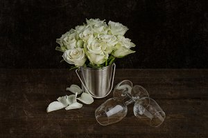 white roses with a pair of glasses