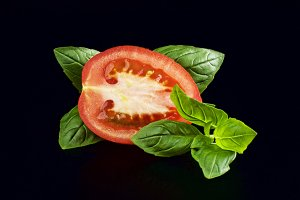 a slice of tomato and basil