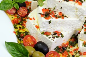 Feta cheese in oil with basil