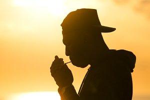 Young Man Smoking Marijuana Sunrise