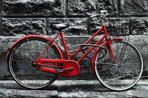 Old charming red bicycle.