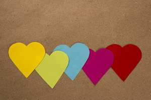Color heart papers in a row