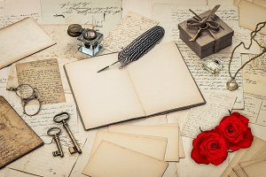 Love letters and red rose flowers