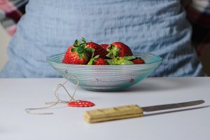 Bowl of fesh strawberries woman stan