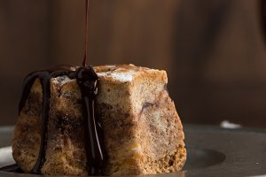 Cake with dark chocolate pourning
