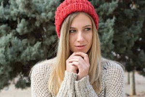 Blonde woman in the winter, red hat