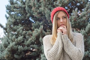 Blonde woman in winter, red hat