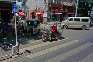 Scooters in a Beijing street scene