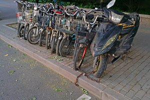 Bikes chained on a Street, China