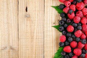 Raspberries on wooden background