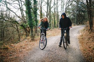 couple with bicycles in the forest