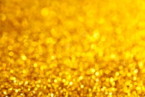 Gold defocused glitter background