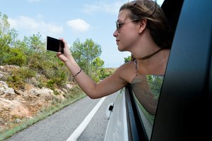 young woman takes a picture