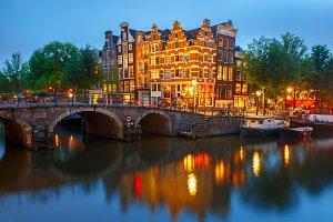 Night Amsterdam canal and bridge