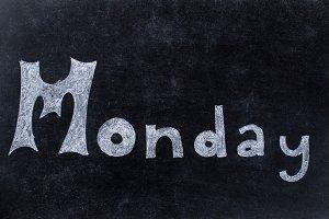 Monday handwritten on blackboard