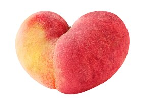 Heart shaped peach fruit isolated