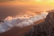 Mountains with low clouds at sunset.