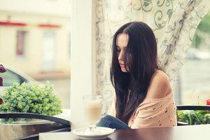Girl dreaming in cafe