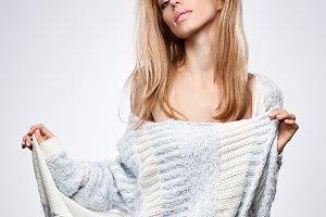 Sexy woman, stylish knitted sweater
