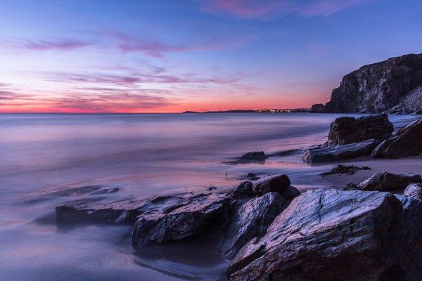 Rocks on coast at sunset
