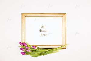 Golden frame with tulips
