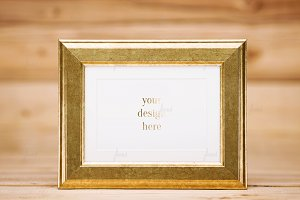 Golden frame on wood background