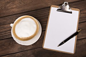 Cappuccino and notepad.