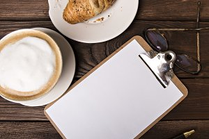 cappuccino, croissant and notepad
