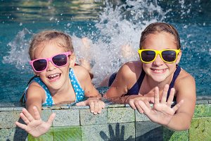 Happy sisters in swimming pool