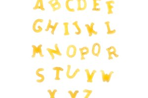 Pasta background with alphabet lette