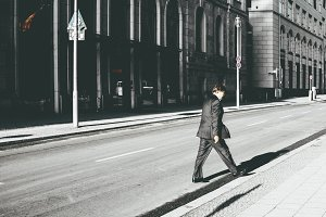 Businessman walking the street