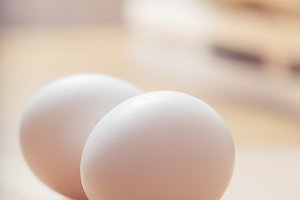 White eggs on the wooden table