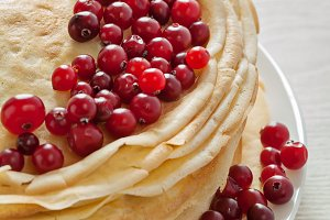 Stack of pancakes with cranberries