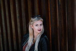 portrait woman near the wooden wall