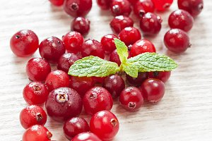 Cranberries on white table