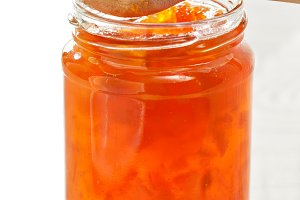 Orange peach jam in jar