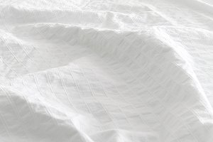 Silky white bed sheet background