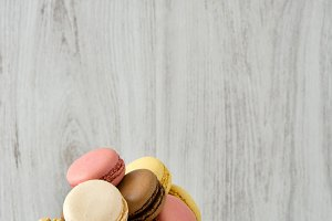Colorful macarons in a vintage bowl