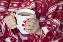 Woman hands and hot coffee
