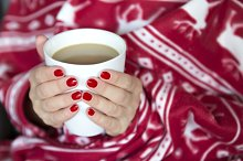 hands holding a mug of hot coffee