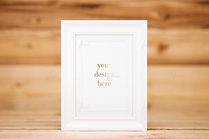 White frame on wood background