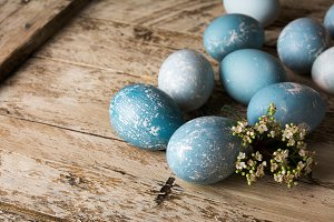 blue easter eggs and flowers