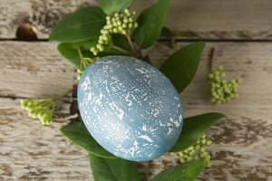 Blue easter eggs on rustic table