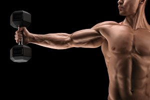 Pumping up muscles with dumbbell