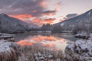 Beautiful sunrise at lake in winter